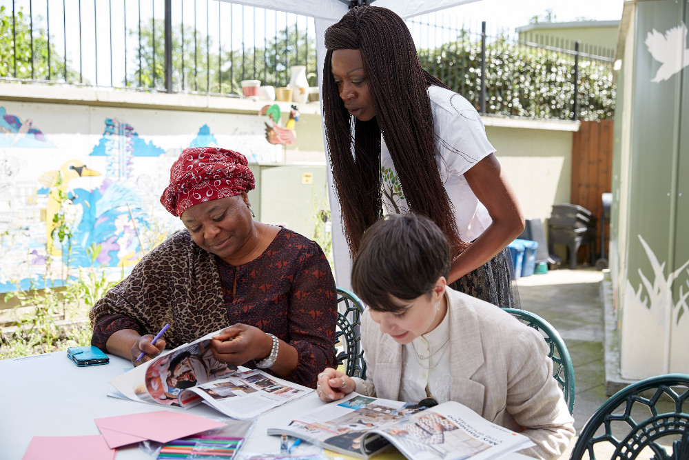 Instructor Fatou Gassama helps two other women with their work