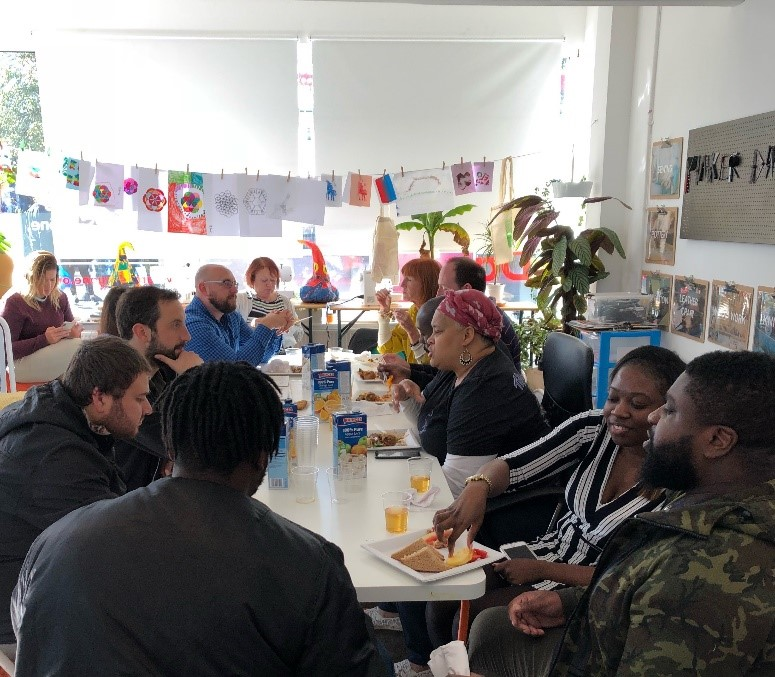 Social entrepreneurs from Barking meeting together in a cafe and talking