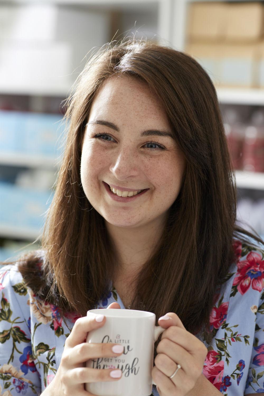Faye Savory profile photo holding a mug