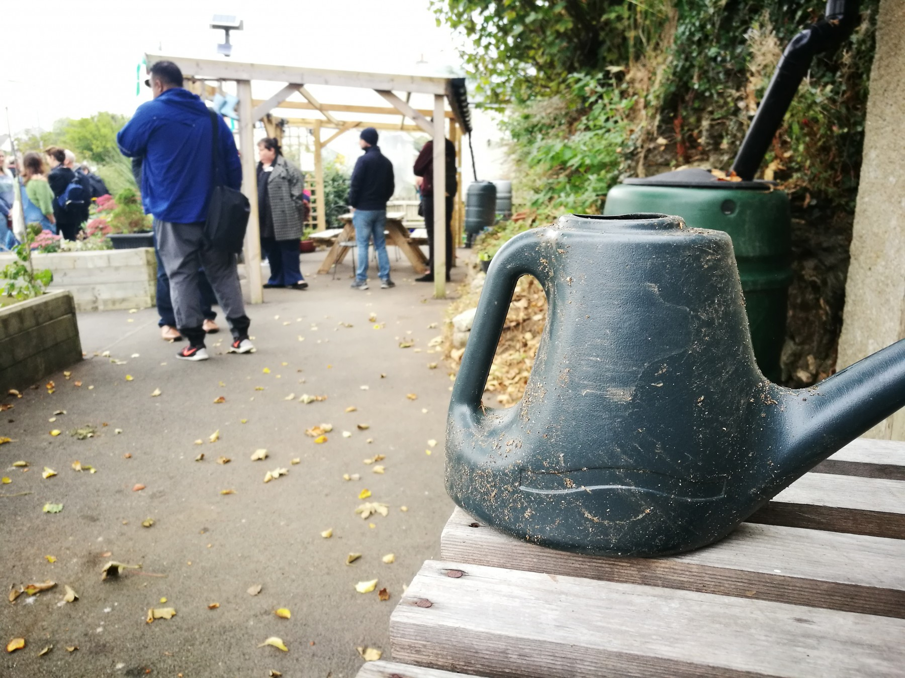 Close up of watering can in community garden